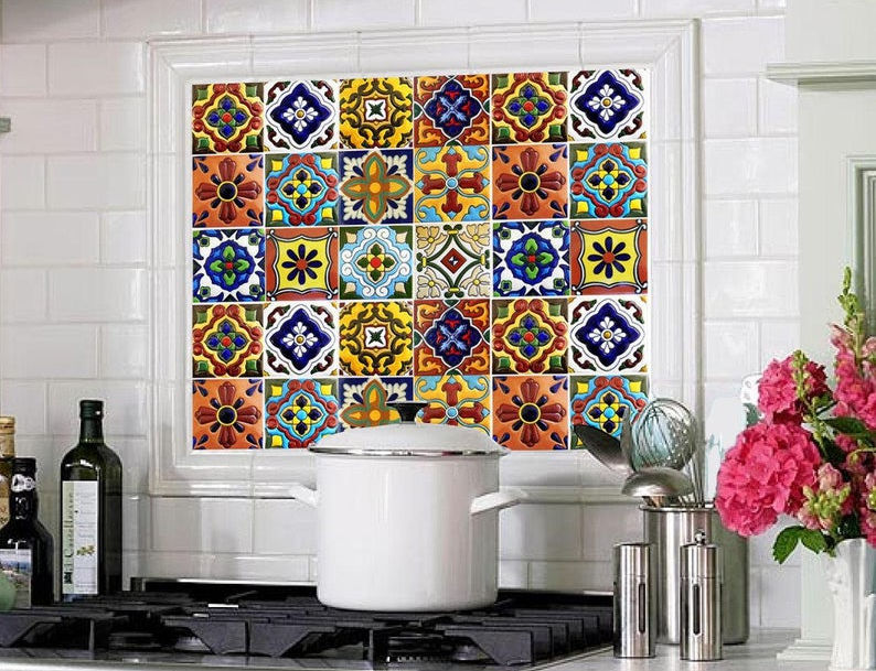 the vinyl tile stickers applied as a backsplash in a kitchen
