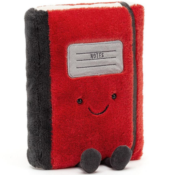 red plush notebook with happy face and feet