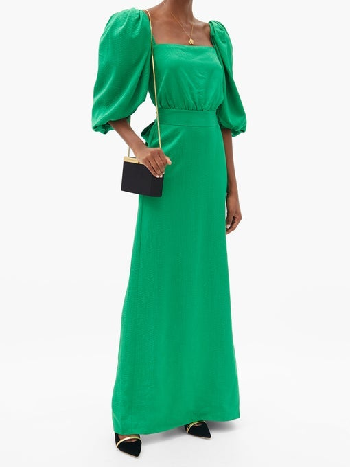 A long crepe dress with a square neckline and puffy sleeves
