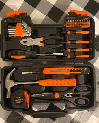 the orange and black set in its case