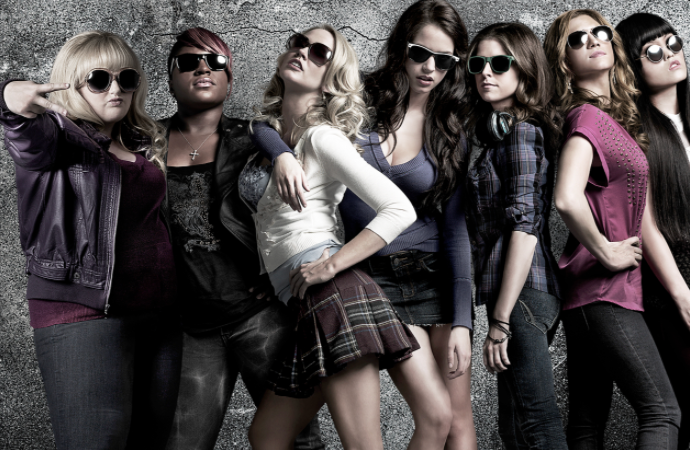 7 women stand next to each other while all wearing sunglasses