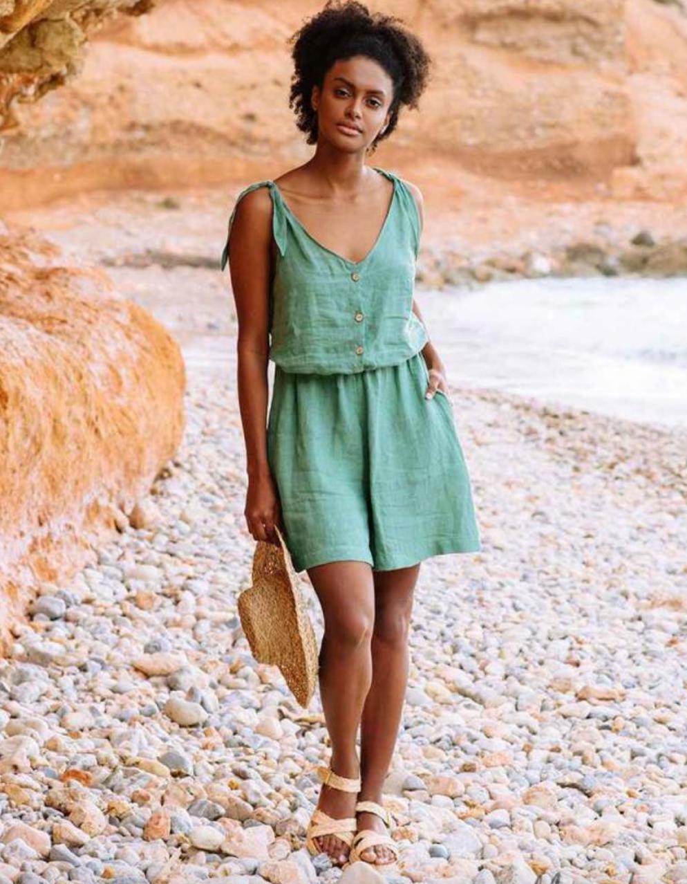 model wearing green romper