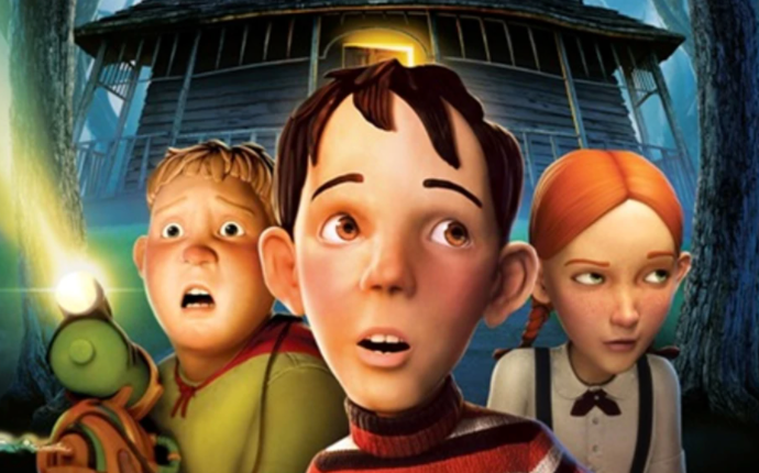 Three kids with wide eyes and open mouths in front of an old house