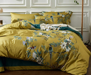 a light green duvet with a peacock print and matching pillows
