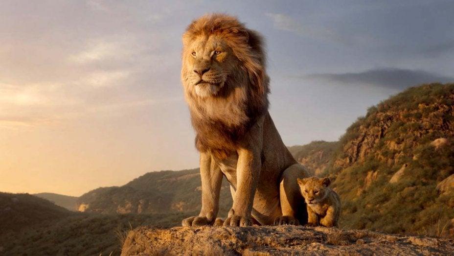 Mufasa and baby Simba stand on a rock