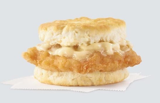 Crispy chicken on a biscuit topped with honey butter
