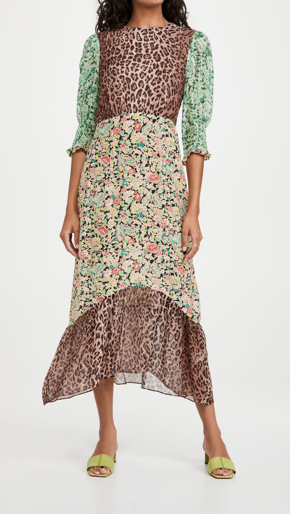 model in midi dress with leopard bodice and hemline, pink, black, and green floral skirt, and green floral three quarter sleeves
