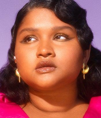 model wearing sparkly brown eyeliner