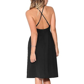 the back of the dress with the criss crossed straps