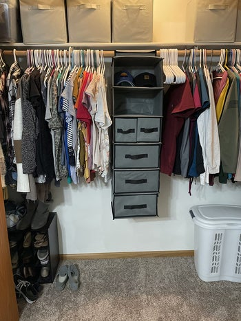 Reviewer photo of the organizer hanging in a closet