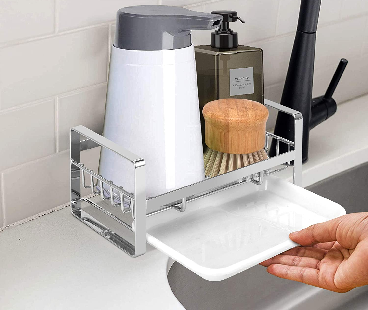 a hand pulling the drip drawer out from under the sink caddy