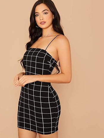 model wearing black version of dress
