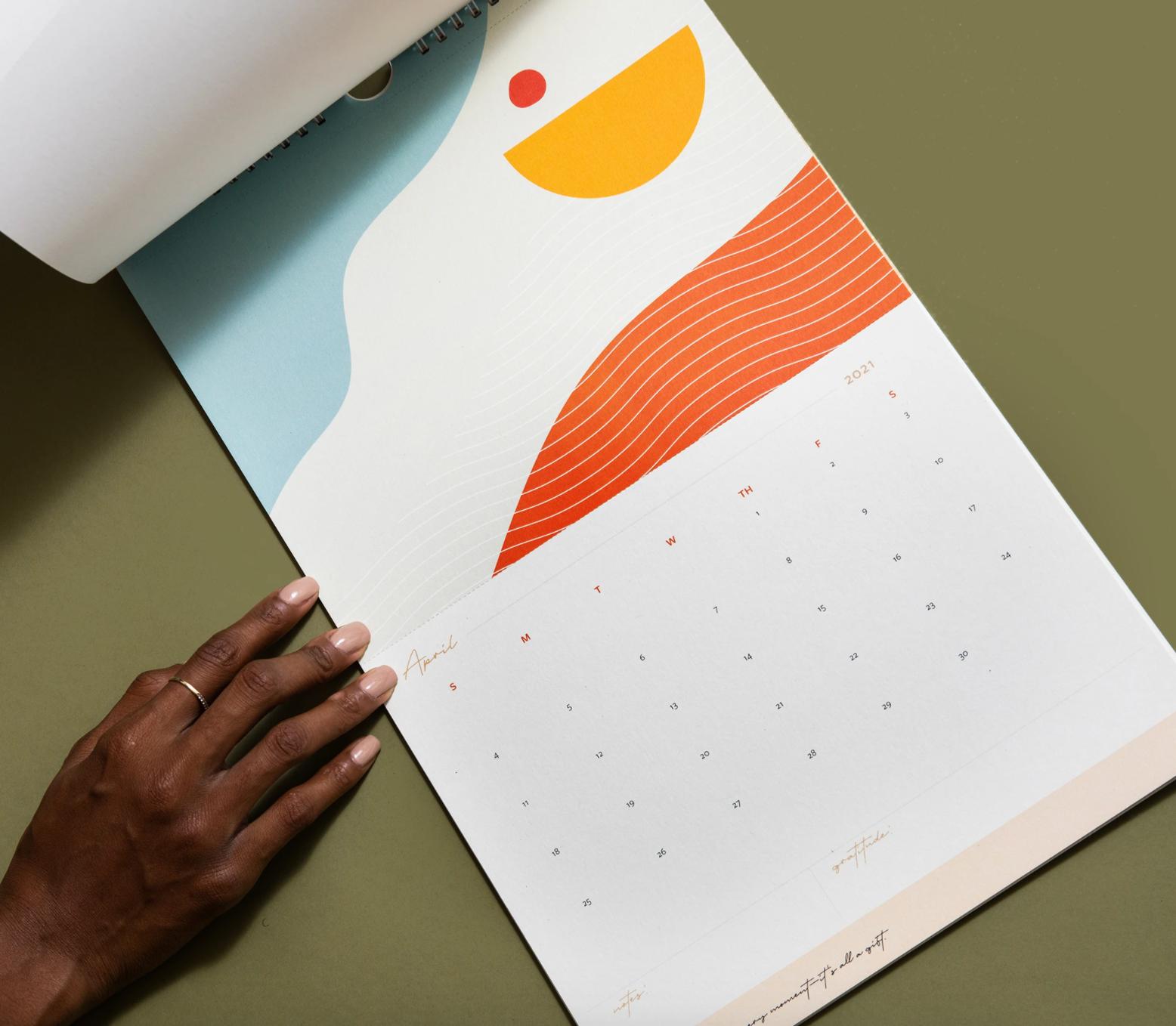 A hand is touching a calendar