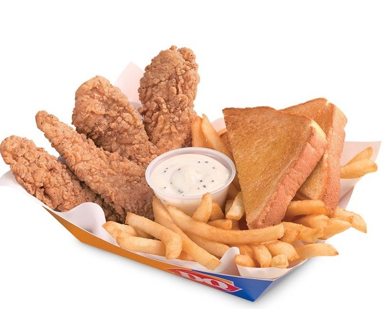 A basket with chicken strips, fries, and toast
