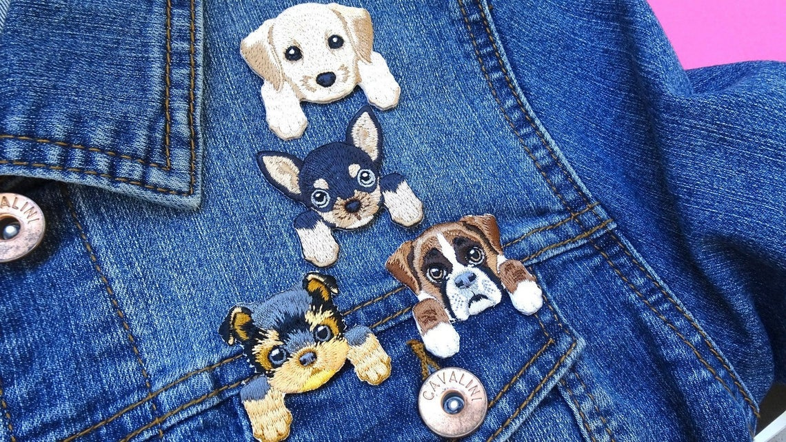 patches shaped like dog faces with front paws