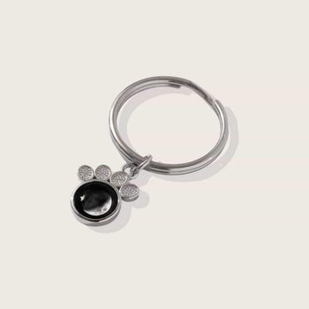 the other side of the keychain with a moon phase on it