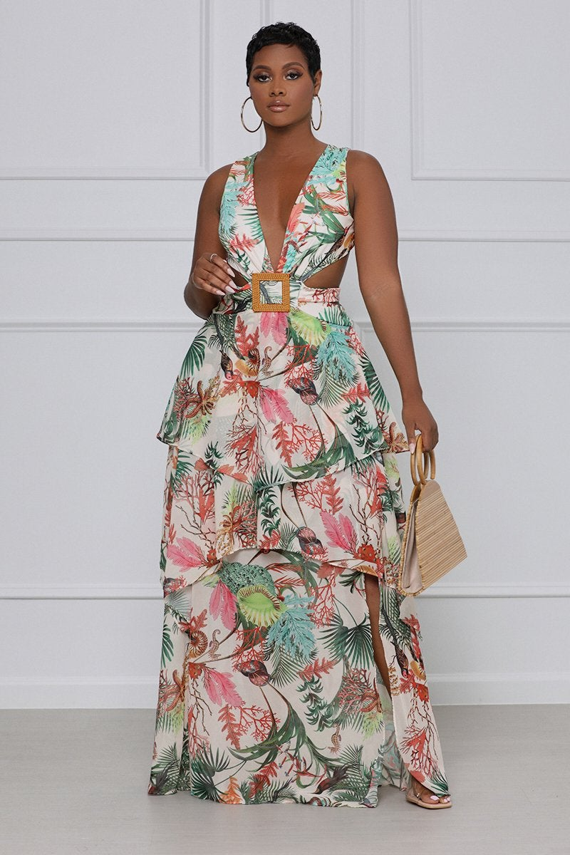 model in the sleeveless white and colorful print dress