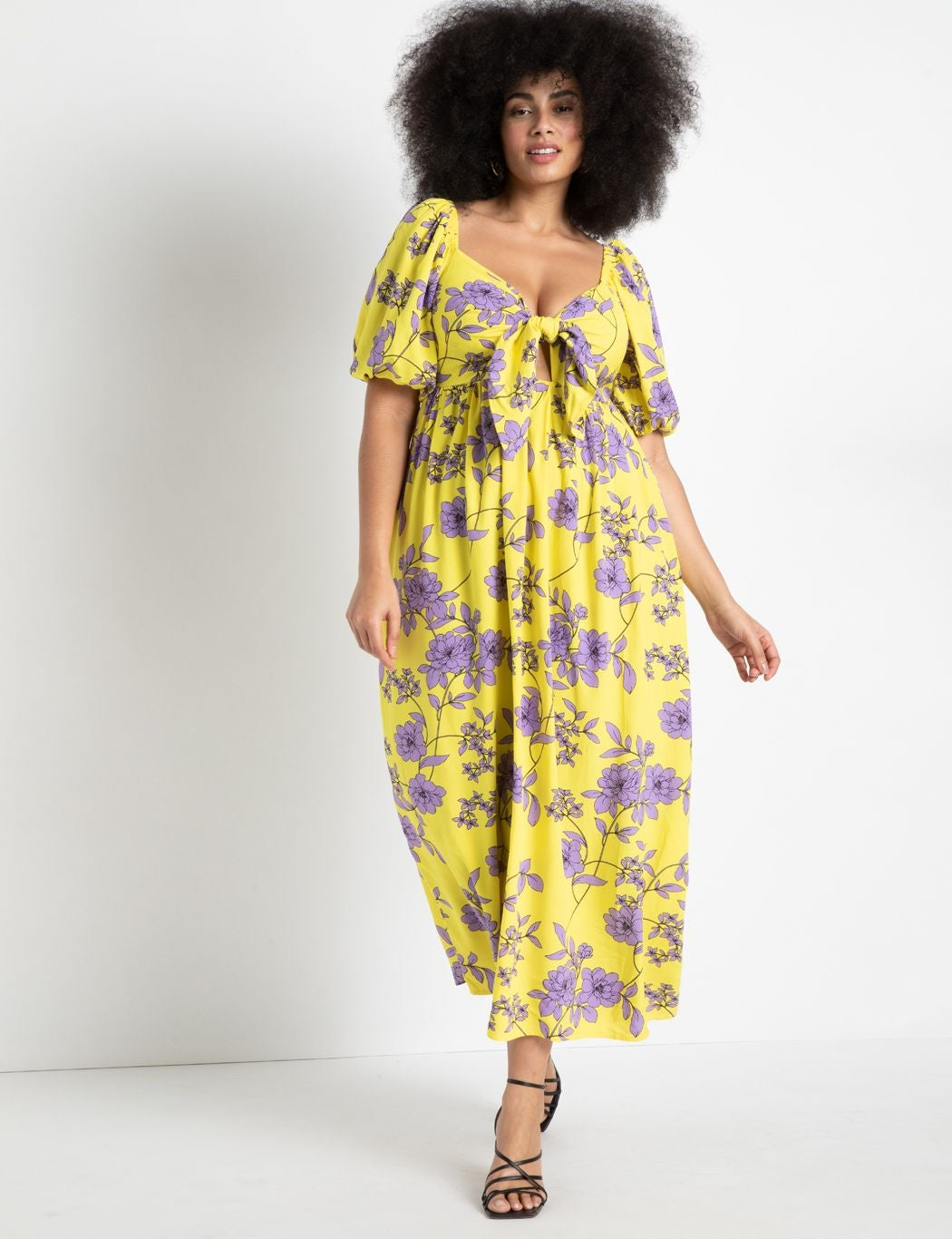 model wearing tie front yellow and purple maxi with short puff sleeves
