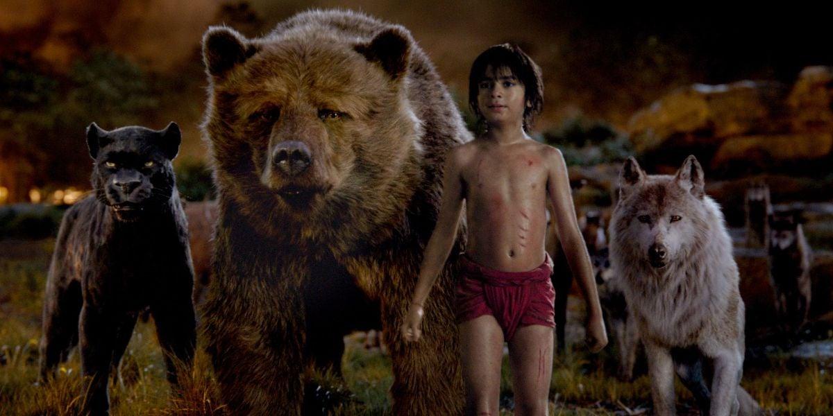 Mowgli stands near his animal friends