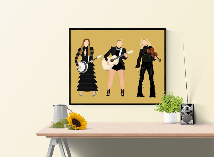art print of the Dixie Chicks illustrated with their instruments on a yellow background