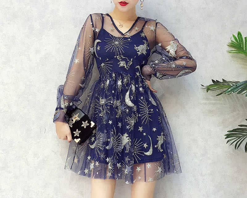 A sheer blue dress with shiny stars and moons embroidered on it