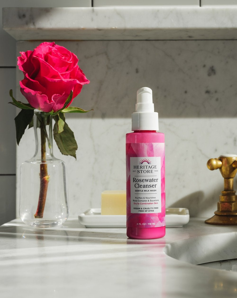 a pink bottle of rosewater cleanser