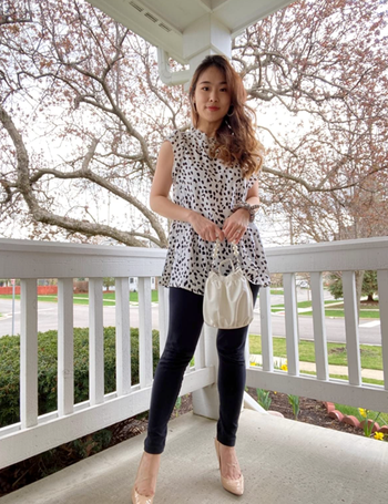 reviewer wearing top with black pants and beige pumps
