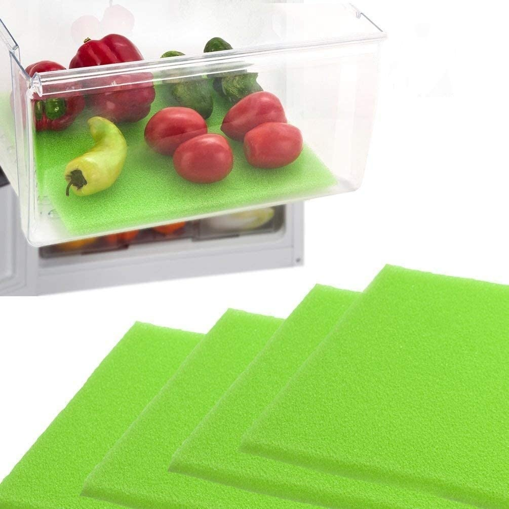 the green foam liners in a drawer with peppers, cucumbers, and tomatoes
