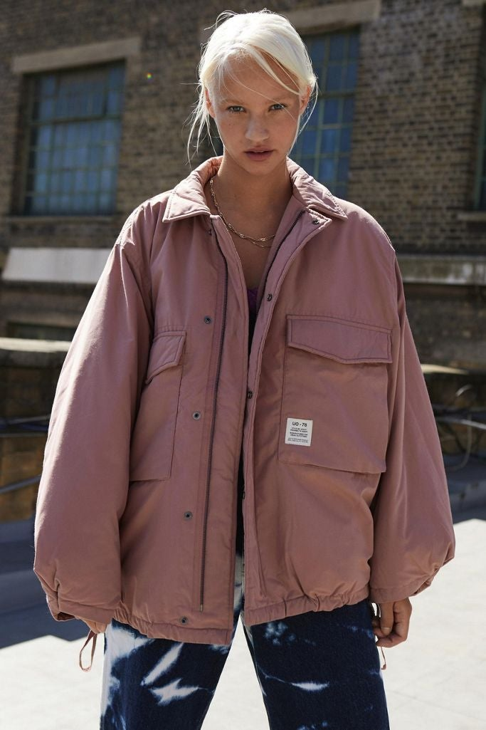A puffy oversized pink coat with big pockets on the front