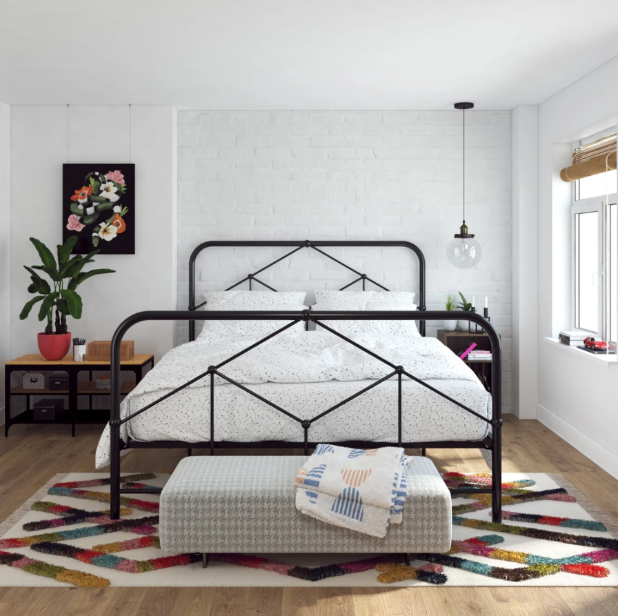 the black metal bed in a room