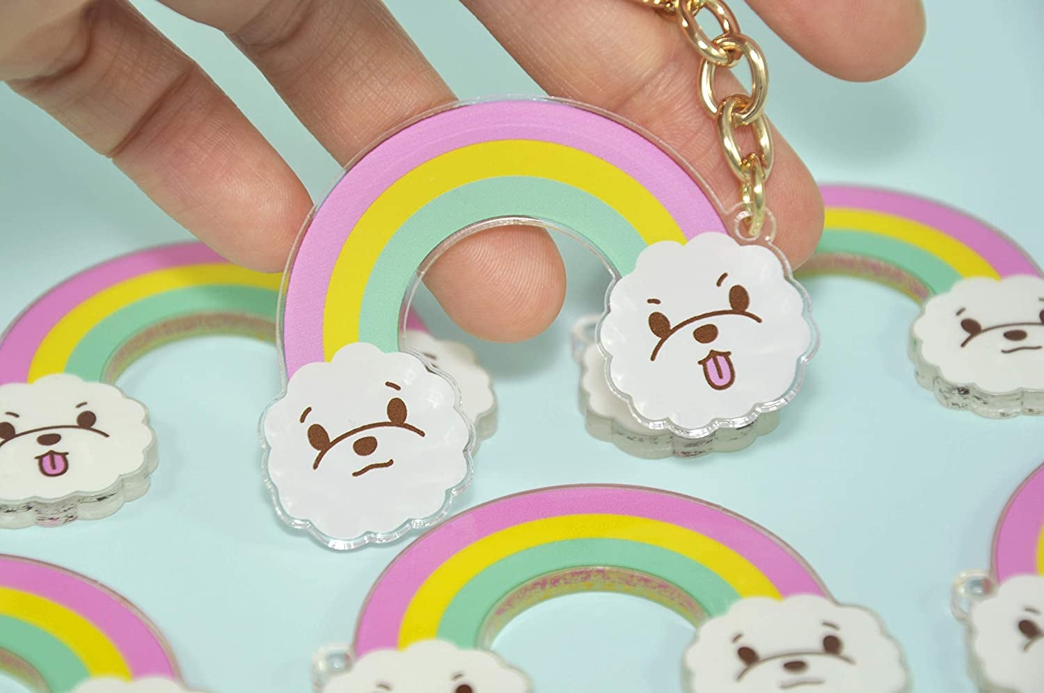 rainbow with bichon faces for the clouds