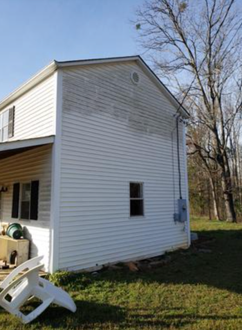 photo showing half of the siding on their house clean after using the spray