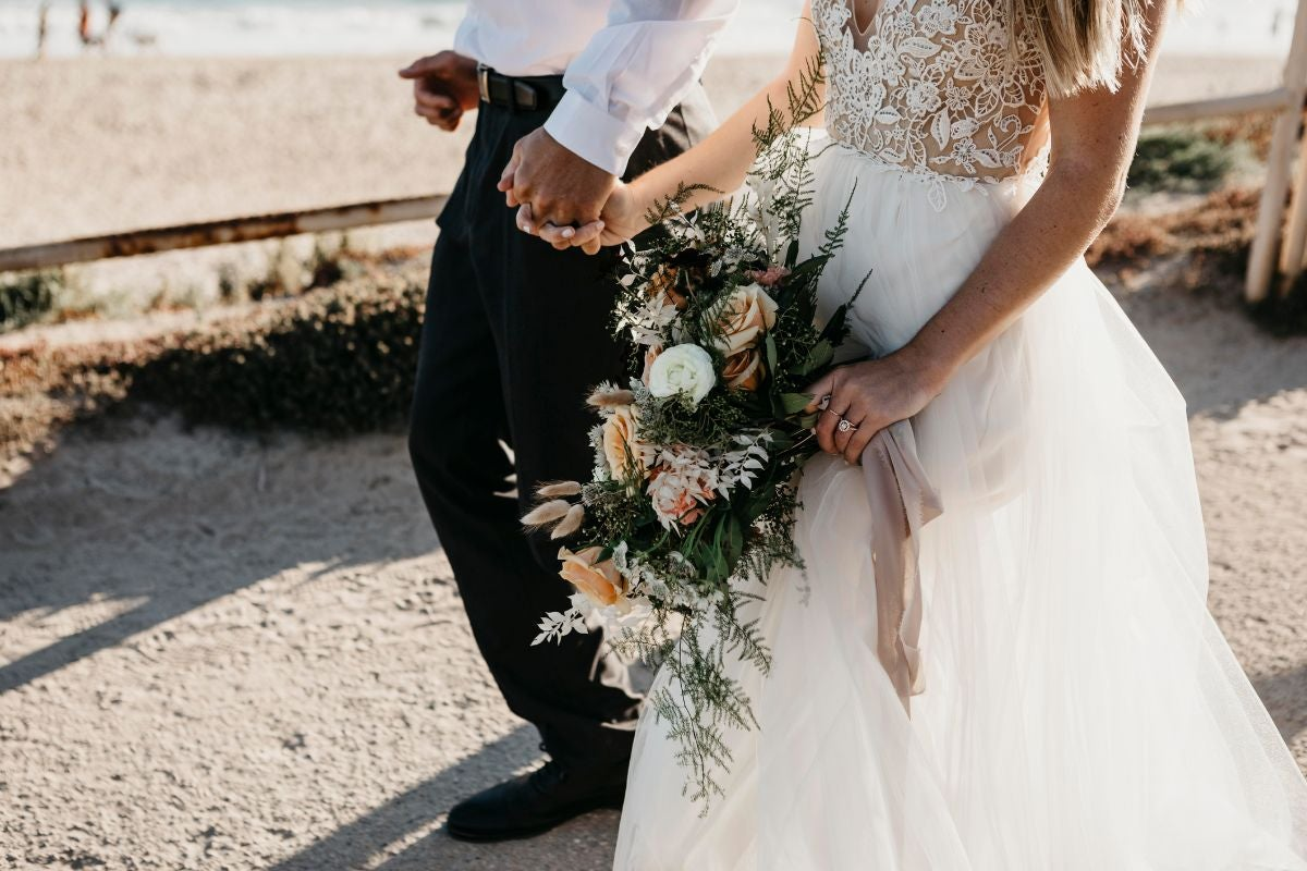 A wedding dress with a floral lacy top and a flowy tulle skirt