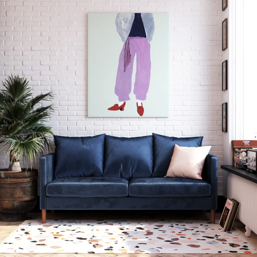 the couch in dark blue in a living room