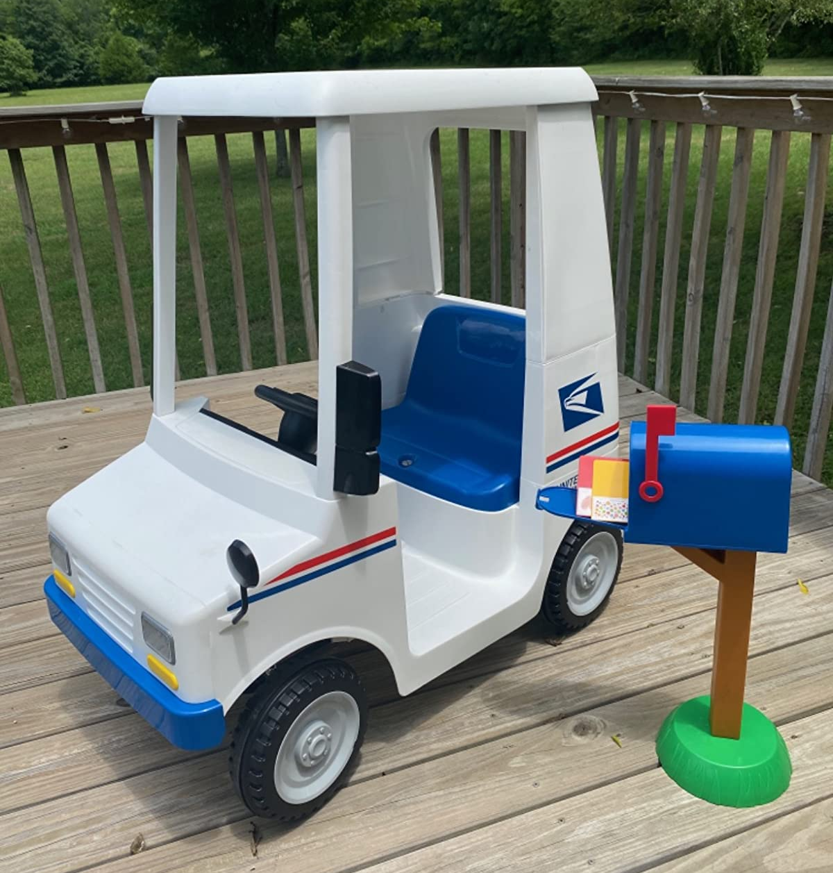 Toy USPS truck with plastic mail box and letters