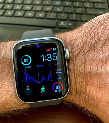 a reviewer photo of someone wearing the apple watch to show sleep tracking