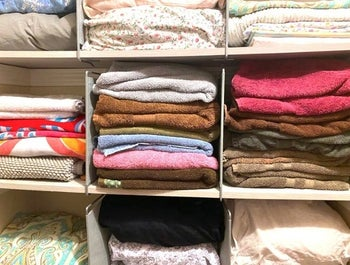 reviewer's linen closet with shelf dividers to divide stacks of towels