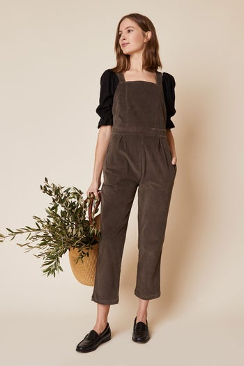 model wearing the cropped overalls in grey