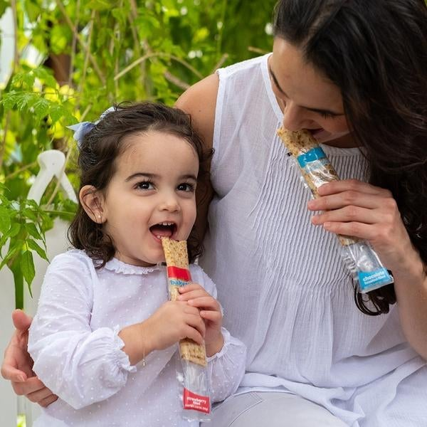 mother and child eat crepe tubes