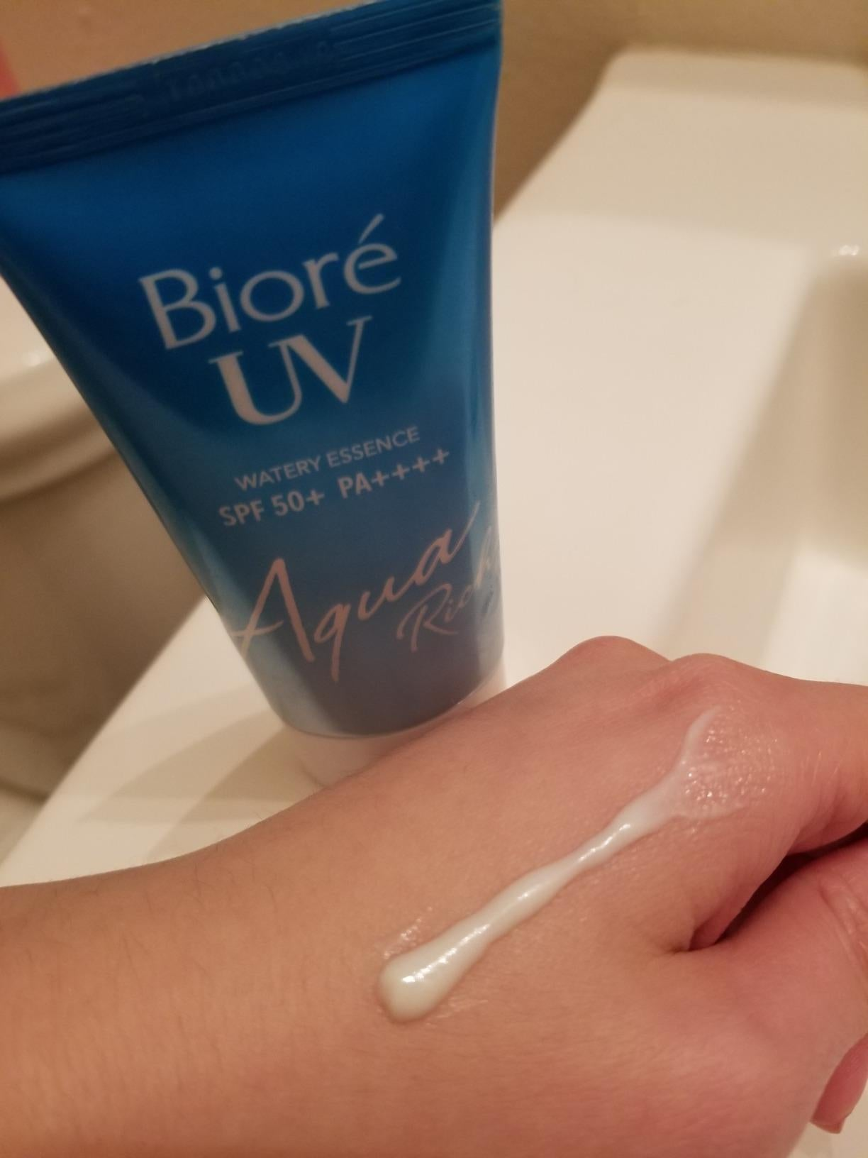 reviewer's hand with a sunscreen swatch on it