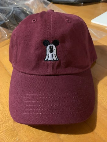 a hat with an embroidered mickey ghost on it