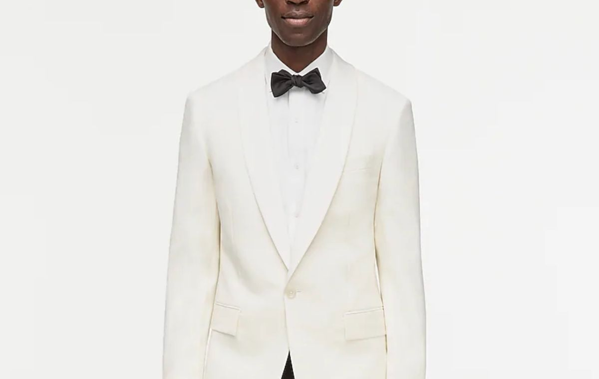 A man in a white suit and bow tie