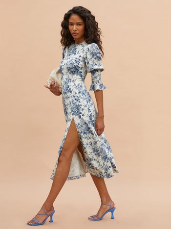 model wearing the white version with light blue floral pattern on it