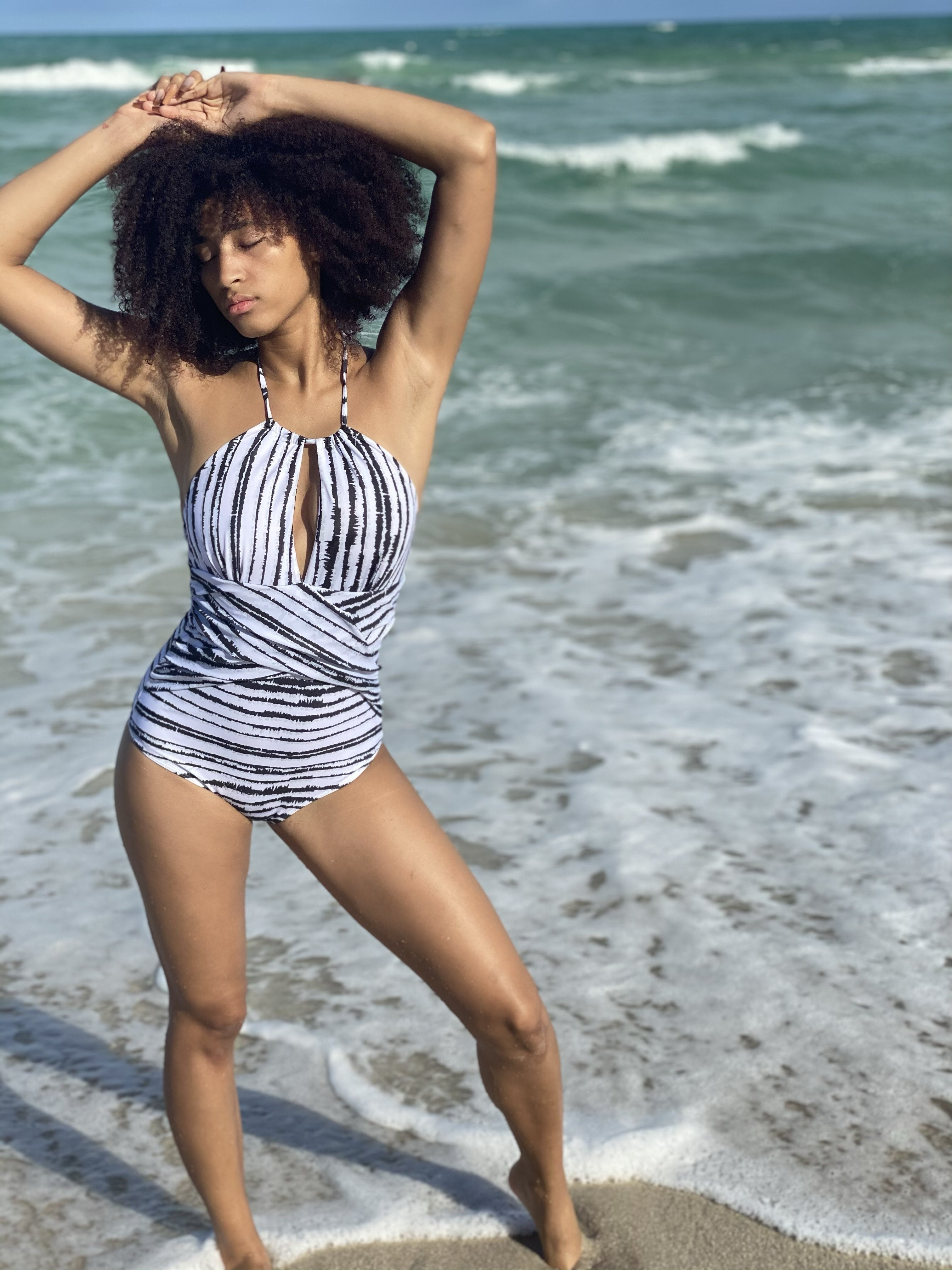 A model in the black and white striped one piece