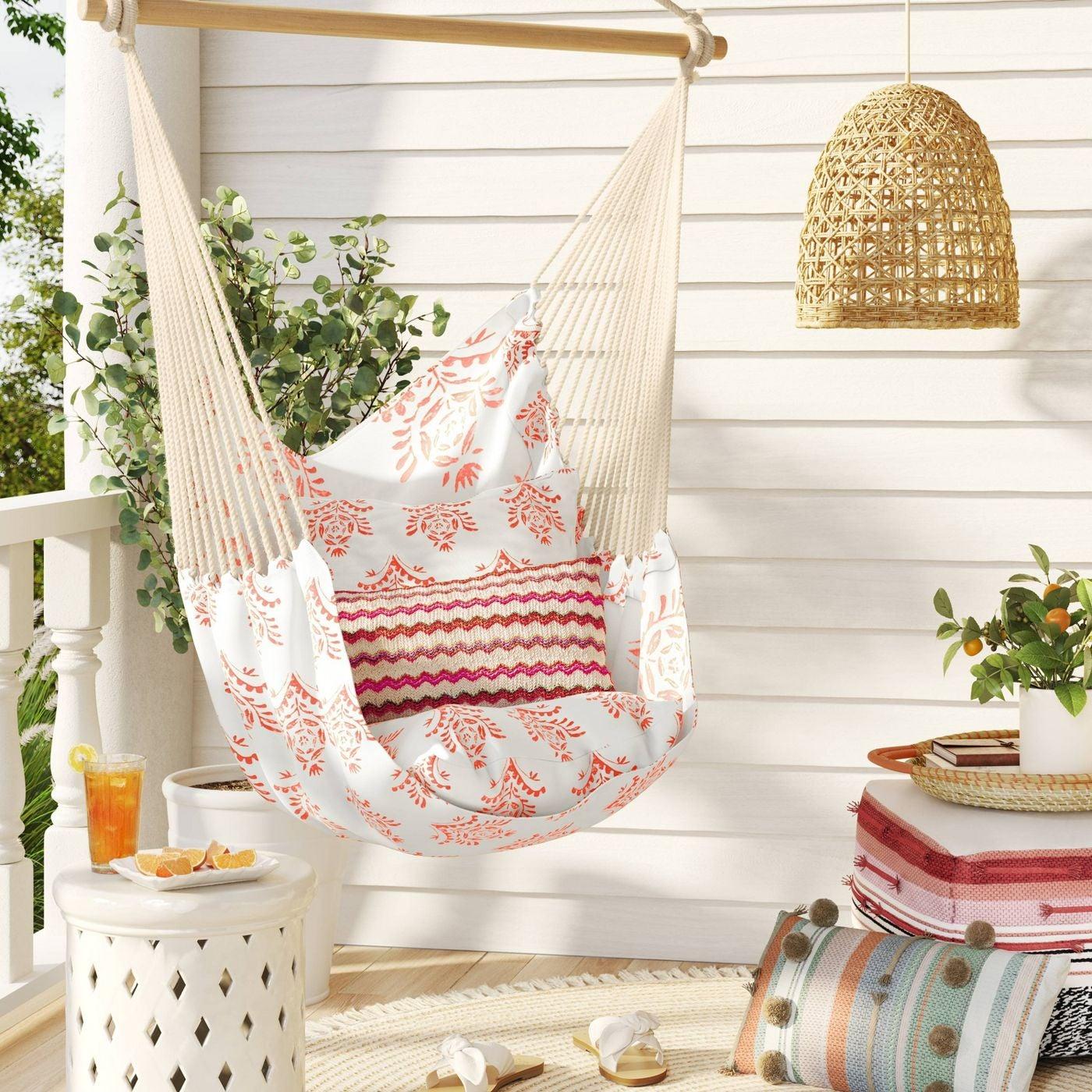 white hammock chair with orange print