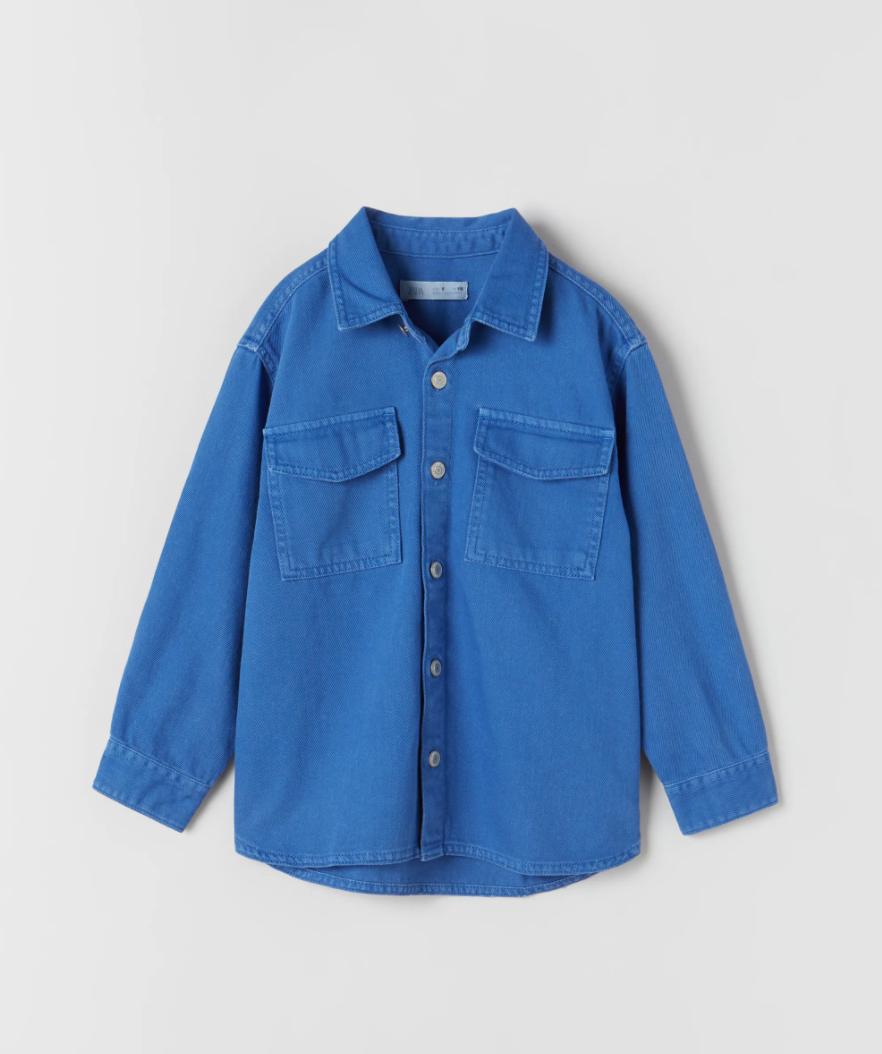 a blue overshirt