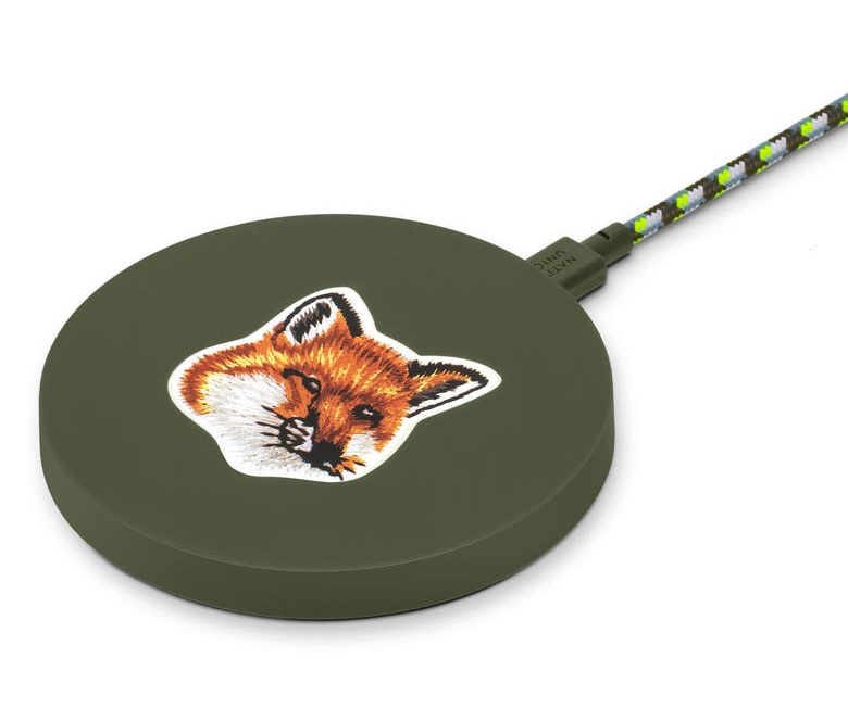 olive green circular charging pad with a fox on it