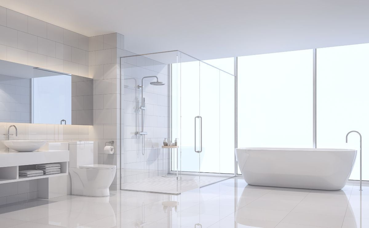 A modern bathroom with a bath tub and shower overlooking a window