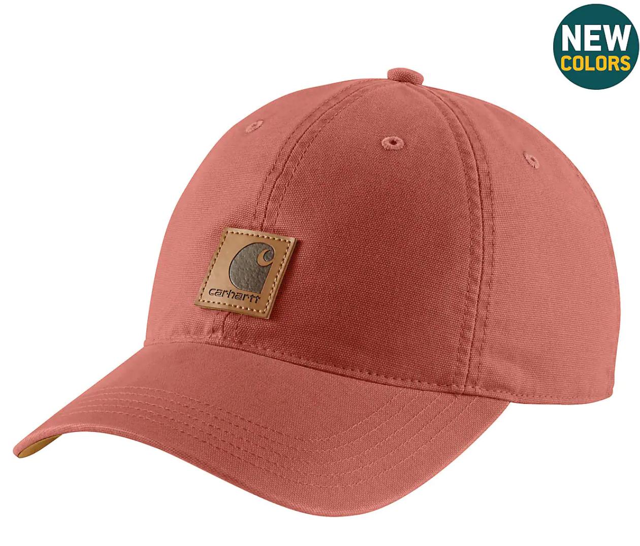 A faded reddish pink baseball hat
