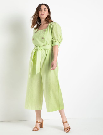 front view of a model in a green double-breasted jumpsuit